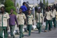 A group of schoolboys is escorted by Nigerian military and officials following their release after they were kidnapped, in Katsina, Nigeria, on Dec. 18. (Sunday Alamba/AP)