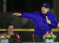 Nicaraguan President Daniel Ortega, with first lady and Vice President Rosario Murillo, speaks at an event in Managua in 2019. (Alfredo Zuniga/AP)