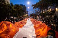 Partidarios del candidato presidencial de izquierda por el partido Perú Libre, Pedro Castillo, marchan en Lima el 19 de junio de 2021. (Ernesto Benavides/AFP vía Getty Images)