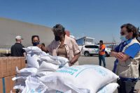 Linda Thomas-Greenfield, the U.S. ambassador to the United Nations, examines aid materials at a border crossing between Turkey and Syria on June 3. (U.S. Embassy in Turkey via AP)
