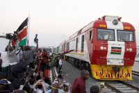 A cargo train rides on a Chinese-backed railway opened by Kenya's president as one of the country's largest infrastructure project since independence, in Mombasa, Kenya, on May 30, 2017. (Khalil Senosi/AP)