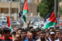 Palestinians protest against Israeli settlements and call for the return of bodies of Palestinians detained by the army, on June 11, in the village of Silwad, near Ramallah in the West Bank. (Abbas Momani/AFP/Getty Images)