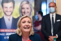 Marine Le Pen, the president of France's far-right National Rally party, speaks at a news conference on Thursday in Saint-Chamond, France. (Philippe Desmazes/AFP/Getty Images)