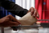 A person casts a vote at a polling station during the first round of French regional and departmental elections, in Le Touquet-Paris-Plage, France, on June 20. (Christian Hartmann/Reuters)
