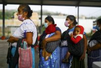 Indigenous Nahuatl in Atzacoaloya, Mexico, on June 6 wait outside a polling station to cast their votes in a midterm election. (Edgard Garrido/Reuters)