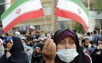 Supporters of Iranian presidential candidate Ebrahim Raisi participate in a campaign rally in Tehran on June 16. (Abedin Taherkenareh/EPA-EFE/Shutterstock)