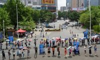 'In order to open its borders, China will first have to vaccinate its population.' People queue to receive the Covid-19 vaccine in Guangzhou in Guangdong province, China. Photograph: Reuters