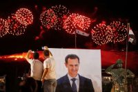 Supporters of Syrian President Bashar al-Assad celebrate last week in Damascus after it was announced that he won another term in office. (Omar Sanadiki/Reuters)