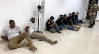 This video image from July 9 shows several men in custody, suspected of being part of the 28-member hit squad accused in the assassination plot of Haitian President Jovenel Moïse. (AFP/Getty Images)