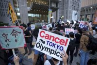People against the July opening of the Tokyo 2020 Olympics, gather to protest around the Tokyo Metropolitan Government building during a demonstration on June 23. (Eugene Hoshiko/AP)