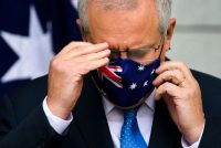 Australian Prime Minister Scott Morrison removes his mask before speaking at a conference following a national cabinet meeting, at Parliament House in Canberra, Australia on July 2. (Lukas Coch/EPA-EFE/REX/Shutterstock)