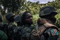 Congolese soldiers enter the town of Mutwanga, partly deserted after recent armed attacks, in northeastern Congo on May 23. (Alexis Huguet/AFP/Getty Images)