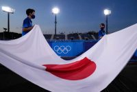 Flag bearers carry the flag of Japan before a men's field hockey match between Japan and Argentina at the Summer Olympics on Sunday. (John Locher/AP)