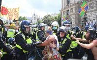 Demonstrators scuffled with the police during an anti-lockdown demonstration in London's Parliament Square on Monday. Credit Facundo Arrizabalaga/EPA, via Shutterstock