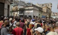 A anti-government protesters march in Havana, Cuba, on Sunday, 11 July, angry over the lack of basic goods and foodstuffs. Photograph: Ismael Francisco/AP