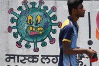 A man walks past an informative coronavirus mural in Mumbai on July 4. (Indranil Mukherjee/AFP/Getty Images)