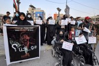 Iraqis demonstrate to demand that authorities hold accountable the killers of dozens of activists associated with a long-running protest movement. (Asaad Niazi/AFP/Getty Images)