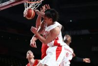 Japan's Daiki Tanaka and Rui Hachimura jump for the ball in the men's preliminary round group C basketball match between Japan and Spain during the Tokyo 2020 Olympic Games at the Saitama Super Arena in Saitama on July 26. (Thomas Coex/AFP/Getty Images)