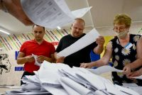 Members of a local electoral commission count ballots in the July 11 legislative elections at a polling station in Chisinau, Moldova. (Sergei Gapon/AFP/Getty Images)