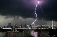 Lightning illuminates the sky over the Olympic rings and the Rainbow Bridge in Tokyo on July 11. (Kyodo News/AP)