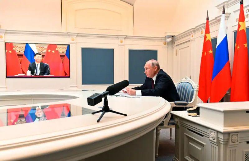 Russian President Vladimir Putin talks with Chinese President Xi Jinping via video conference in Moscow on June 28. (Alexei Nikolsky, Sputnik, Kremlin Pool Photo via AP)