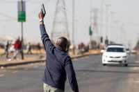 A man fired a handgun in the air in the Vosloorus township of South Africa to disperse suspected looters on July 14. The events of the past weeks demonstrated a bleak truth about the country. Credit Guillem Sartorio/Agence France-Presse — Getty Images