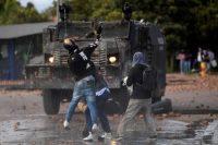 Demonstrators clash with riot police in the Suba neighborhood in Bogota, Colombia, on June 29. (Raul Arboleda/AFP/Getty Images)