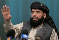 Suhail Shaheen, Afghan Taliban spokesman and a member of the negotiation team gestures while speaking during a joint news conference in Moscow on July 22. (Alexander Zemlianichenko/AP)