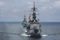 Japan's Maritime Self-Defense Force destroyers JS Murasame and JS Akebono participate in a drill off the coast of Brunei In 2019. (Emily Wang/AP)