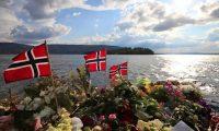 A memorial in Sundvollen overlooking Utøya island near Oslo, Norway, a few days after the 22 July 2011 assault. Photograph: Lefteris Pitarakis/AP