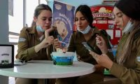 Israeli soldiers eat at the Ben & Jerry's factory in Be'er Tuvia on Wednesday. Photograph: Emmanuel Dunand/AFP/Getty Images
