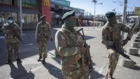 Members of the South African National Defense Force patrol the streets after the looting of local department stores in Soweto, South Africa, on Tuesday. (Kim Ludbrook/EPA-EFE/Shutterstock)