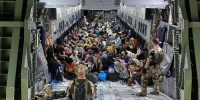 Evacuees from Kabul arrive at Tashkent, Uzbekistan in a military aircraft following the Taliban takeover of Afghanistan. Photo by Handout/Bundeswehr via Getty Images.