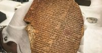 """A portion of the """"Epic of Gilgamesh,"""" which was looted from Iraq and sold for $1.6 million to Hobby Lobby for display in the Museum of the Bible, on July 28. (AP)"""