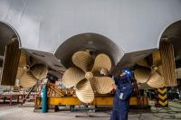 A worker polishes the rear propellers of a 115-foot patrol boat in the Paramount Maritime Holdings shipyard in Cape Town, South Africa, on July 1. A proliferation of pirate attacks in the Gulf of Guinea, an expanse of the Atlantic Ocean stretching from Senegal to Angola, is driving a security-boat building boom in South Africa. (Dwayne Senior/Bloomberg News)