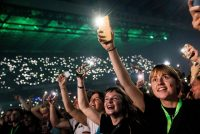 People attend a performance by Danish band the Minds of 99, on Sept. 11, in Copenhagen. (Olafur Steinar Gestsson/AFP/Getty Images)