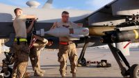 U.S. Air Force ground crew secure weapons and other components of an MQ-9 Reaper drone after it returned from a mission, at Kandahar Airfield, Afghanistan, 9 March 2016. REUTERS/Josh Smith