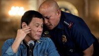 This file photo taken on 30 January 2017 shows Philippine President Rodrigo Duterte (L) talking to then Philippine National Police (PNP) director general Ronald Dela Rosa (R) during a press conference at the Malacanang palace in Manila. Noel CELIS / POOL / AFP