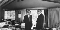 President Richard Nixon and Treasury Secretary John Connally discuss new economic programmes for the United States at Camp David in Maryland, 1971. Photo by PhotoQuest/Getty Images.