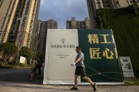 A resident walks through the Evergrande community in Wuhan, Hubei Province, China, on Sept. 24. Evergrande, China's largest property developer, is facing a liquidity crisis with total debts of around $300 billion. (Getty Images)