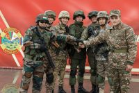 Service members from India, Kazakhstan, Kyrgyzstan, Uzbekistan, Armenia and Russia pose during joint Russian-Belarusian drills on the Mulino training ground in the Nizhny Novgorod region, Russia, on Sept. 9, in a photo made available by the Russian Defense Ministry. (EPA-EFE/Shutterstock)