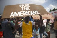 Protesters demand the release of kidnapped Americans near the missionaries' headquarters in Titanyen, north of Port-au-Prince, Haiti, on Oct. 19. (Joseph Odelyn/AP)
