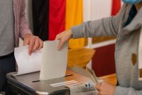 A voter casts his ballot at a polling station during federal parliamentary elections in Berlin on Sept. 26. (Krisztian Bocsi/Bloomberg News)