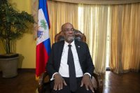 Haitian Prime Minister Ariel Henry attends an interview at his private residence in Port-au-Prince on Sept. 28. (Joseph Odelyn/AP)