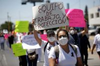 Medical personnel in Mexico last year, after the death of a colleague, protested the lack of personal protective equipment and other supplies to treat Covid-19 patients. Credit Jose Luis Gonzalez/Reuters