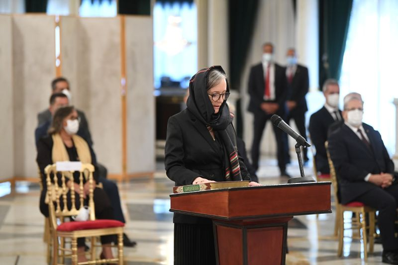 Tunisian Prime Minister Najla Bouden Romdhan takes the oath during the country's new government swearing-in ceremony on Oct. 11, 2021, in Tunis. (Tunisian Presidency/Via Reuters)